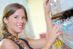 Prety blonde customer shopping at local supermarket. Pretty Royalty Free Stock Photos