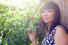 Prety woman in summer rose garden Royalty Free Stock Image