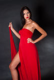 Prety woman wearing red fabric like a dress Royalty Free Stock Photo