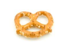 Pretzel. A macro shot of a pretzel over a white background Royalty Free Stock Photography