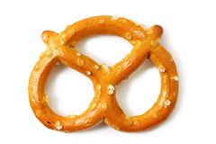Pretzel. Single salted pretzel, casting shadow on white Royalty Free Stock Photos