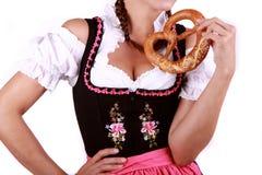 Pretzel. Bavarian pretzel with woman in dirndl stock photo