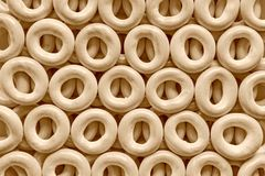 Pretzel or bagels for background of color sepia Royalty Free Stock Images