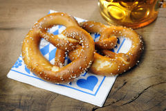 Pretzel and beer on bavarian napkin Royalty Free Stock Photo