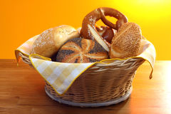 Pretzel  and buns in bread basket Royalty Free Stock Photo