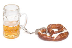 Pretzel chained with handcuffs to beer mug Stock Images