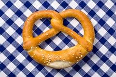 Pretzel on checkered napkin. The pretzel on checkered napkin Royalty Free Stock Images