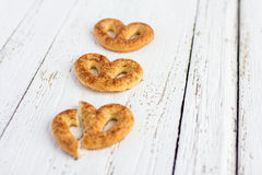 Pretzel with cinnamon and sugar. On white table Royalty Free Stock Images
