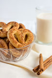 Pretzel with cinnamon and sugar. On a white table and a glass of milk Royalty Free Stock Images