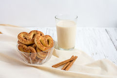 Pretzel with cinnamon and sugar. On a white table and a glass of milk Stock Images