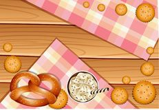 Pretzel and crackers on wooden board. Illustration Stock Image