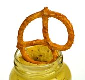 Pretzel in jar of mustard Royalty Free Stock Image