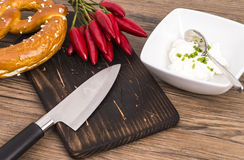 Pretzel knife and chili Stock Images