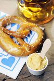Pretzel, Obatzter and beer on bavarian napkin Royalty Free Stock Image