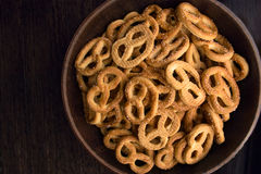 Pretzel in a plate. On the table, dark background stock photos