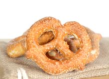 Pretzel ring style bread on burlap Royalty Free Stock Photo