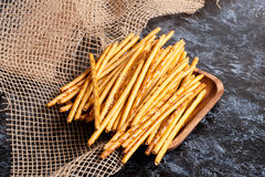 Pretzel rods (stick) on wooden plate Royalty Free Stock Photos
