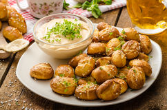 Pretzel rolls with cheese dip Stock Images