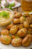 Pretzel rolls with cheese dip Royalty Free Stock Images