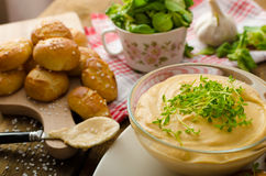 Pretzel rolls with cheese dip Royalty Free Stock Photos
