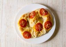 Pretzel with salami. Hot baked Pretzel with salami stock images