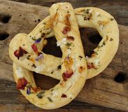 Pretzel with salt and floral spices. Rustic pretzel with floral spices and salt Royalty Free Stock Photos
