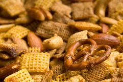 Pretzel Snack Mix Background. Close Up of cereal, pretzel, and nut snack mix background Royalty Free Stock Image