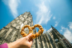 Pretzel soft snack in front of Cologne. Cathedral Royalty Free Stock Image