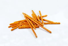 Pretzel sticks. Closeup of a pile of pretzel sticks royalty free stock photography