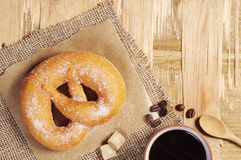 Pretzel with sugar and coffee Stock Image