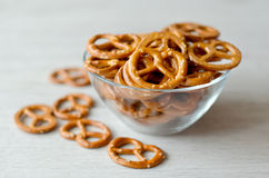 Pretzel. Sylty snack in a bowl, selective focus Stock Photos