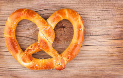 Pretzel on wooden background. German Pretzel on wooden background Royalty Free Stock Photography