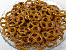 Pretzels. On a clear glass plate with white background stock photos