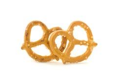 Pretzels. Two fresh, salty pretzels.  White background Stock Image