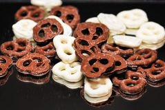 Pretzels. Chocolate and yogurt pretzels together on a black background Royalty Free Stock Images
