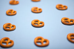 Pretzels on blue background Stock Photography