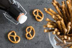 Pretzels with bottle of beer. stock photos