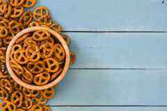 Pretzels in bowl. On blue wooden table.copyspace Stock Image