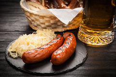 Pretzels, bratwurst and sauerkraut Royalty Free Stock Photo