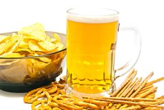 Pretzels, breadsticks, chips and beer closeup Royalty Free Stock Images