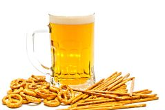 Pretzels, breadsticks and light beer. Breadsticks, pretzels and light beer on white closeup Royalty Free Stock Photography