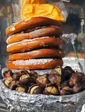 Pretzels and chestnuts on vendors cart Royalty Free Stock Photography