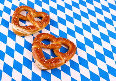 Pretzels in heart shape on white blue background Stock Photography