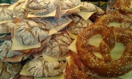 Pretzels. Large ham and cheese pretzels. Market food. Salzburg. Austria Royalty Free Stock Photography