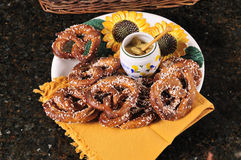 Pretzels with mustard dip stock photos