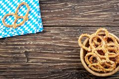Pretzels on a napkin on wooden table. Bavarian oktoberfest pretz. Pretzels on napkin on wooden table. Bavarian oktoberfest pretzel. Top view with copy space Stock Images