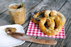 Pretzels with salt and grainy mustard, snack food for picknick Royalty Free Stock Photography