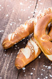 Pretzels with salt on wood Royalty Free Stock Images