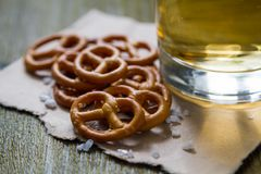Pretzels with salt on wood background Royalty Free Stock Photo
