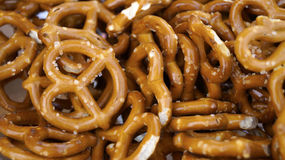Pretzels. Texture background pretzels, a bunch of fried oiled pretzels stacked together food snack, salted cooked fresh pretzel Stock Photos